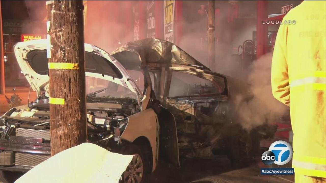 A mangled vehicle following a deadly and fiery crash that left a driver dead in Granada Hills early Sunday, March 18, 2018.