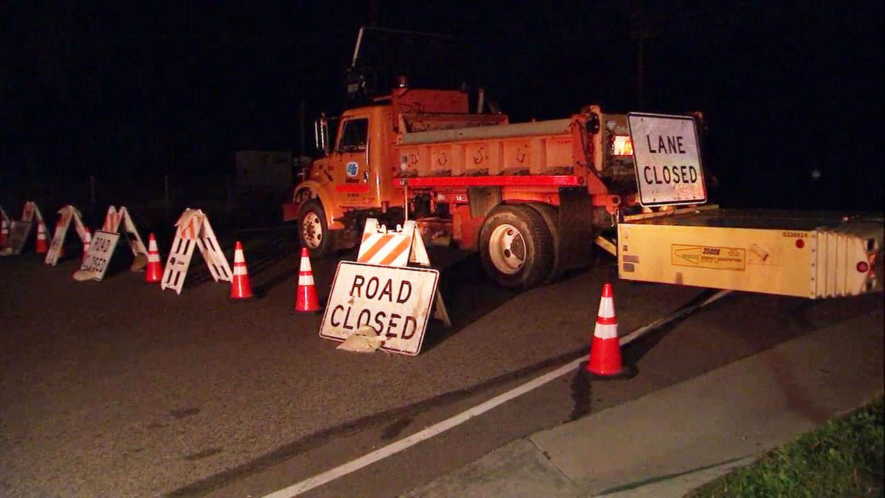 A stretch of Topanga Canyon Boulevard seen closed following a crash that knocked down power lines on Monday, March 19, 2018.