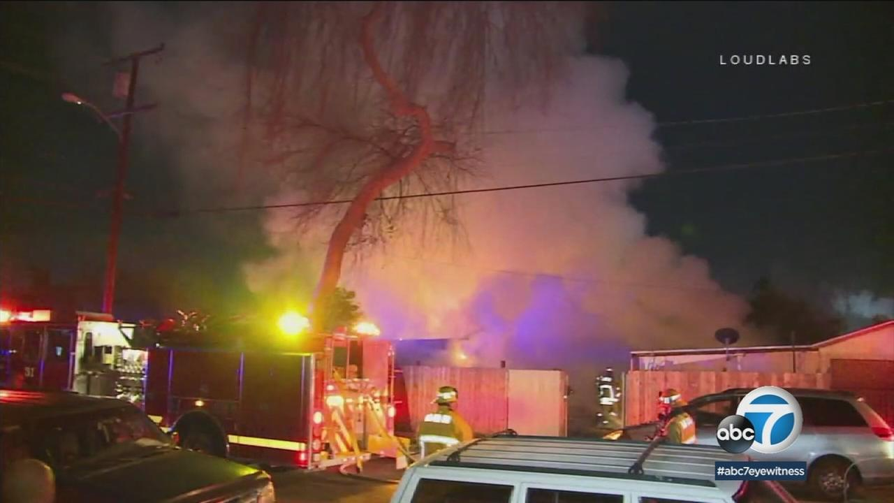A woman and her teenage grandchild were critically injured and two dogs were killed after an explosive fire at a Compton home.
