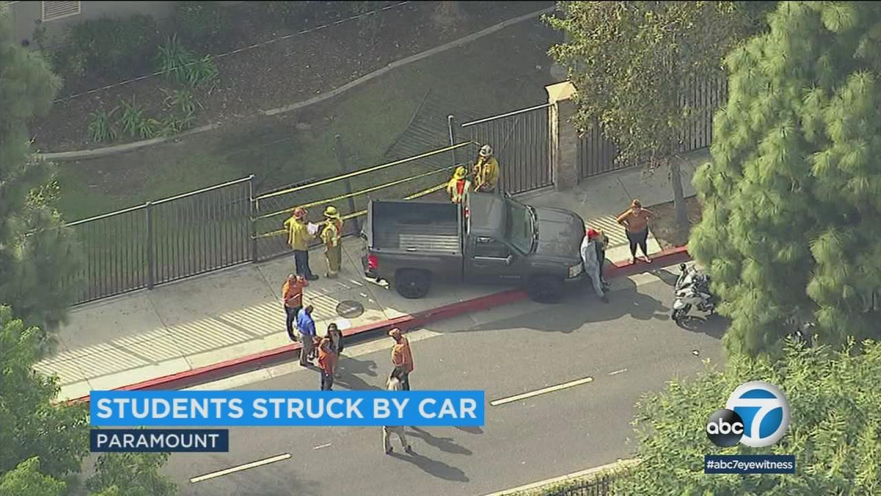 A 19-year-old pickup driver was arrested for reckless driving after striking four student pedestrians near Paramount High School, officials said.