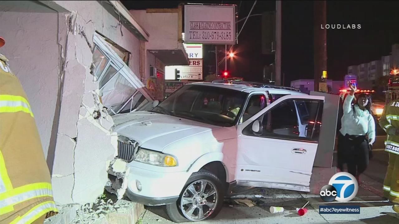 An SUV sits inside a home after the impact from a crash caused it to veer into the residence in Hawthorne.