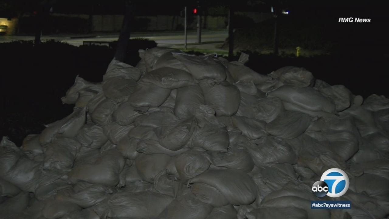 Sandbags were set up around areas of Corona that were affected by the Canyon Fire as heavy rains are expected early Thursday.