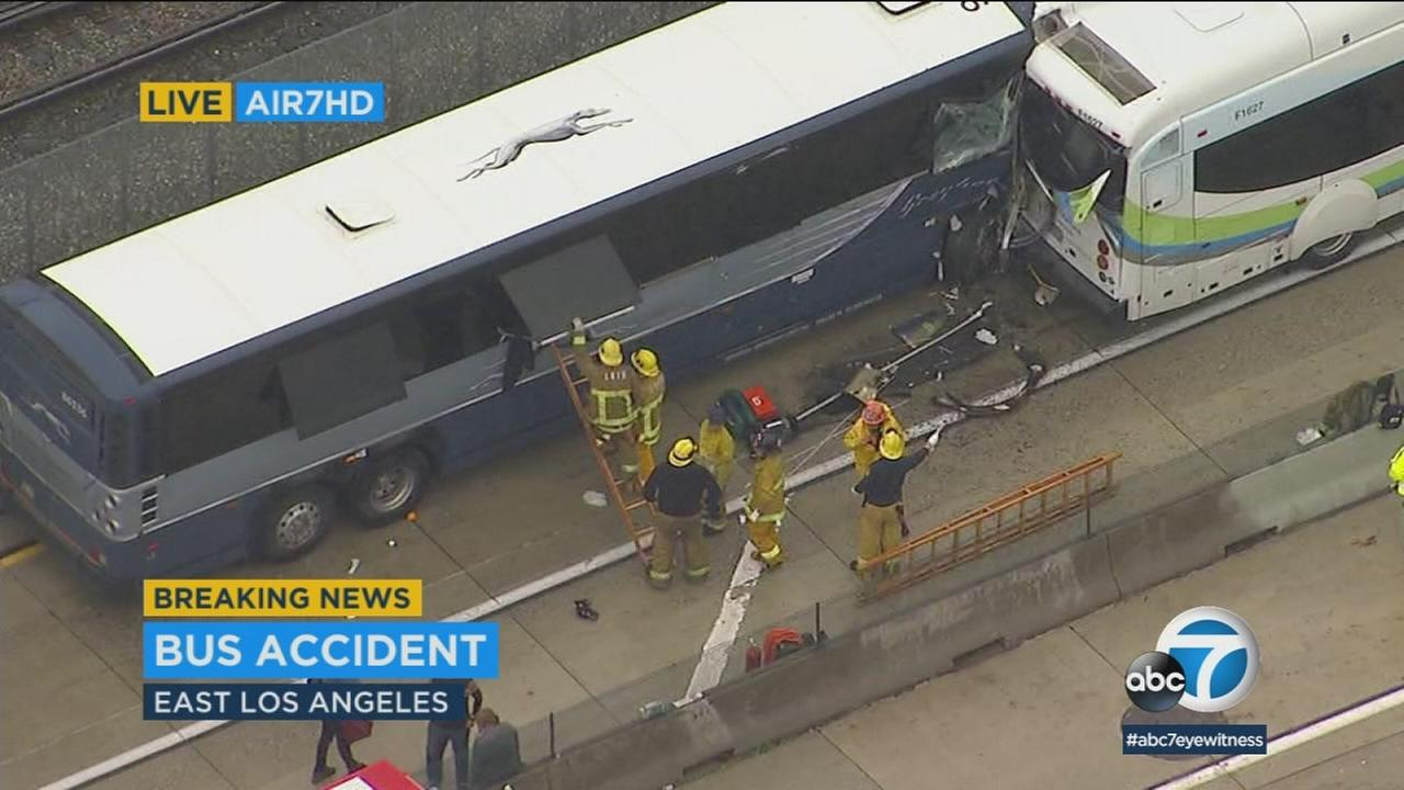 Emergency personnel are seen in East Los Angeles, where multiple people were injured in a bus crash on Thursday, March 22, 2018.
