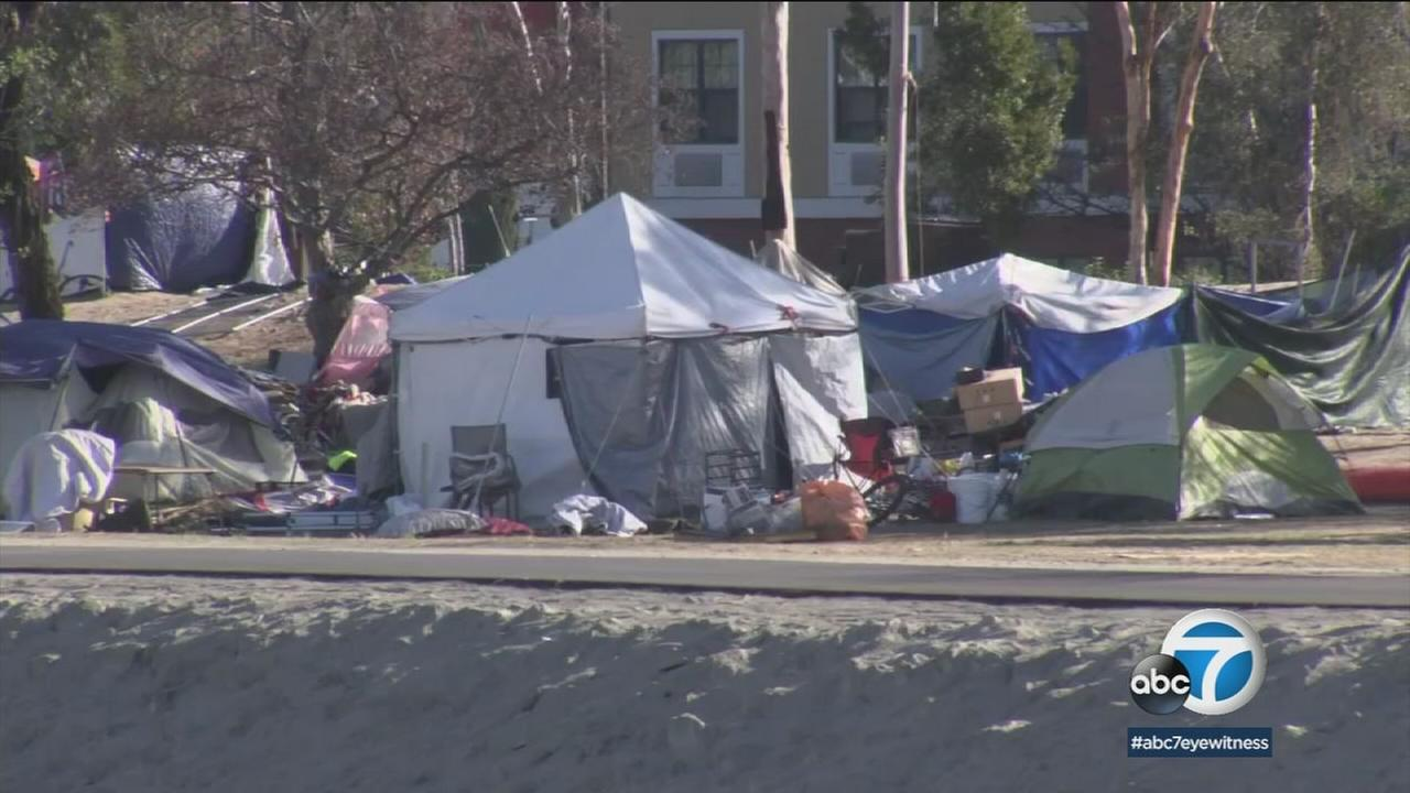 A homeless encampment is shown in a photo in Orange County.