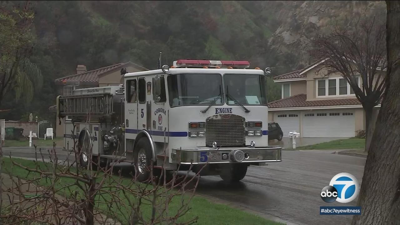 A firetruck was shown in a soaked neighborhood in Corona that was affected by the Canyon Fire.