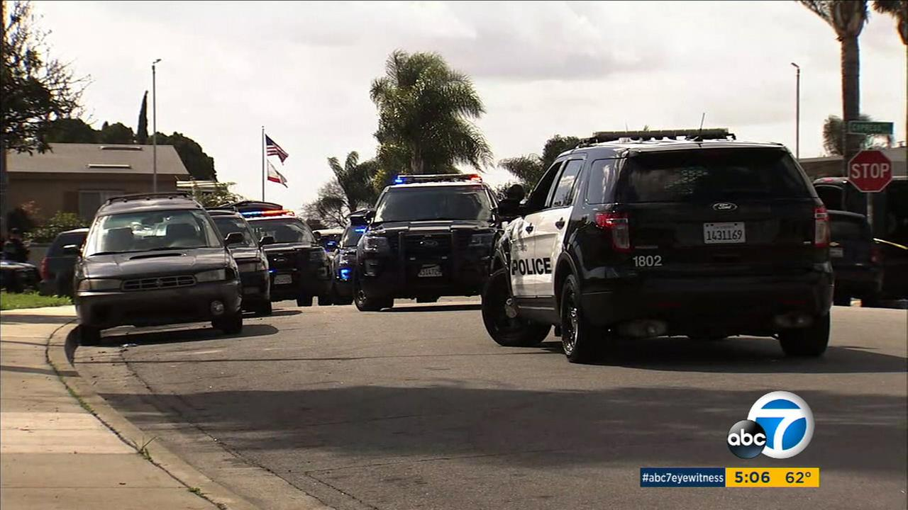 Police on Saturday surrounded a home a home in Chino where a suspect was believed to be holed up after a stabbing that left a woman critically wounded.
