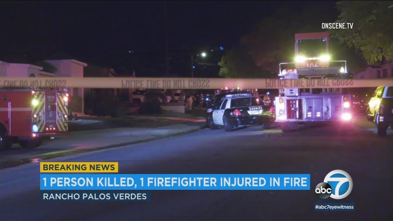 One person was killed early Tuesday morning in a house fire in Rancho Palos Verdes that also left two people injured, including a firefighter, officials said.