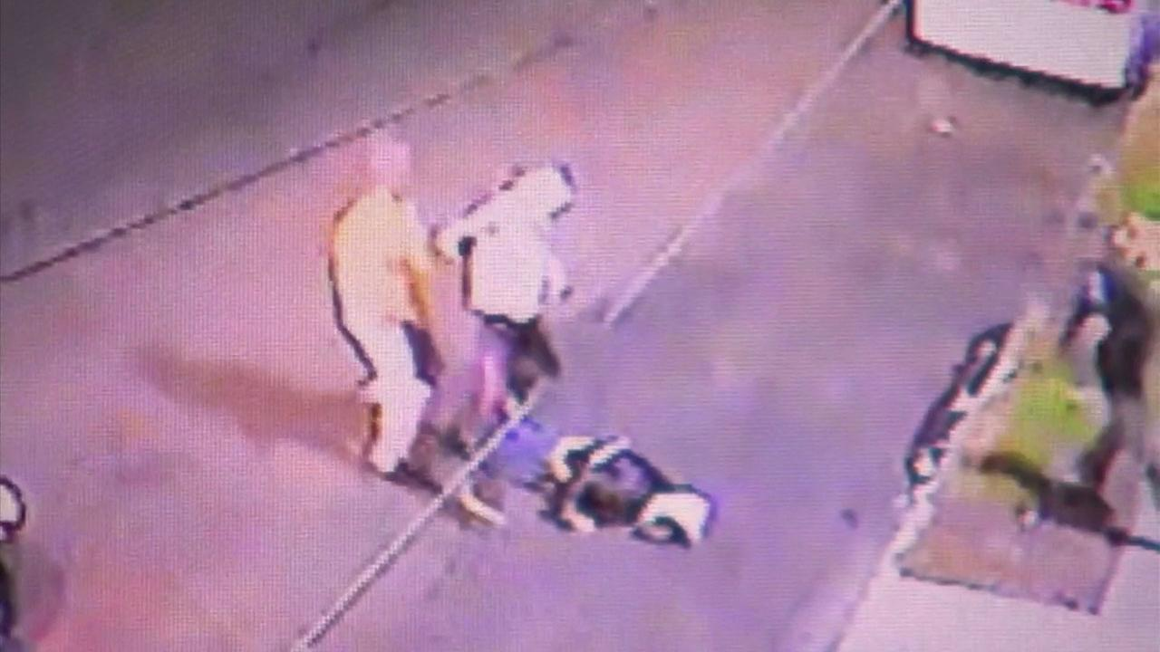Surveillance video shows people attacking one of three street vendors in the early morning hours of March 18, 2018, in South Los Angeles.
