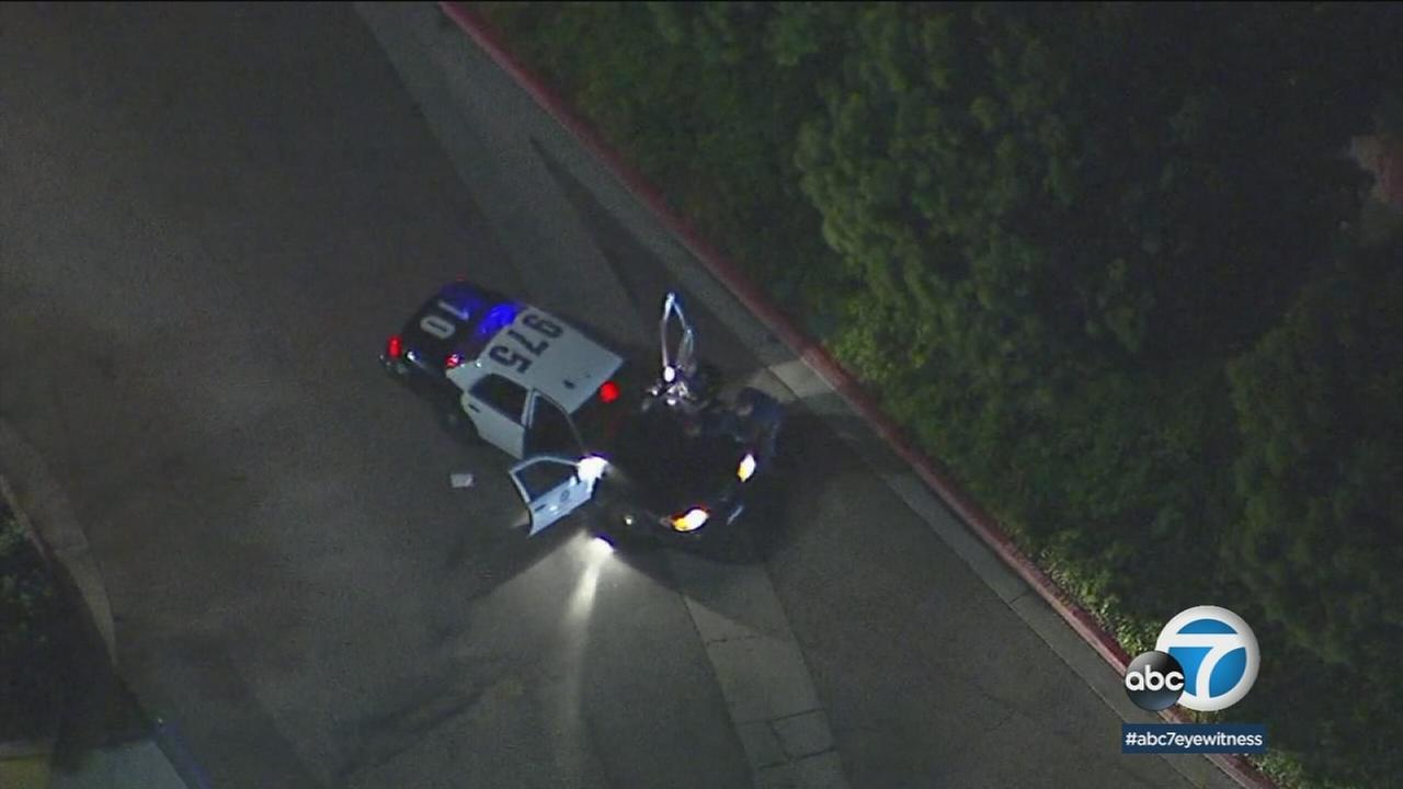 Two burglary suspects were arrested after trying to hide by driving into a hospital parking garage after a high-speed chase that started in the San Fernando Valley Wednesday night.
