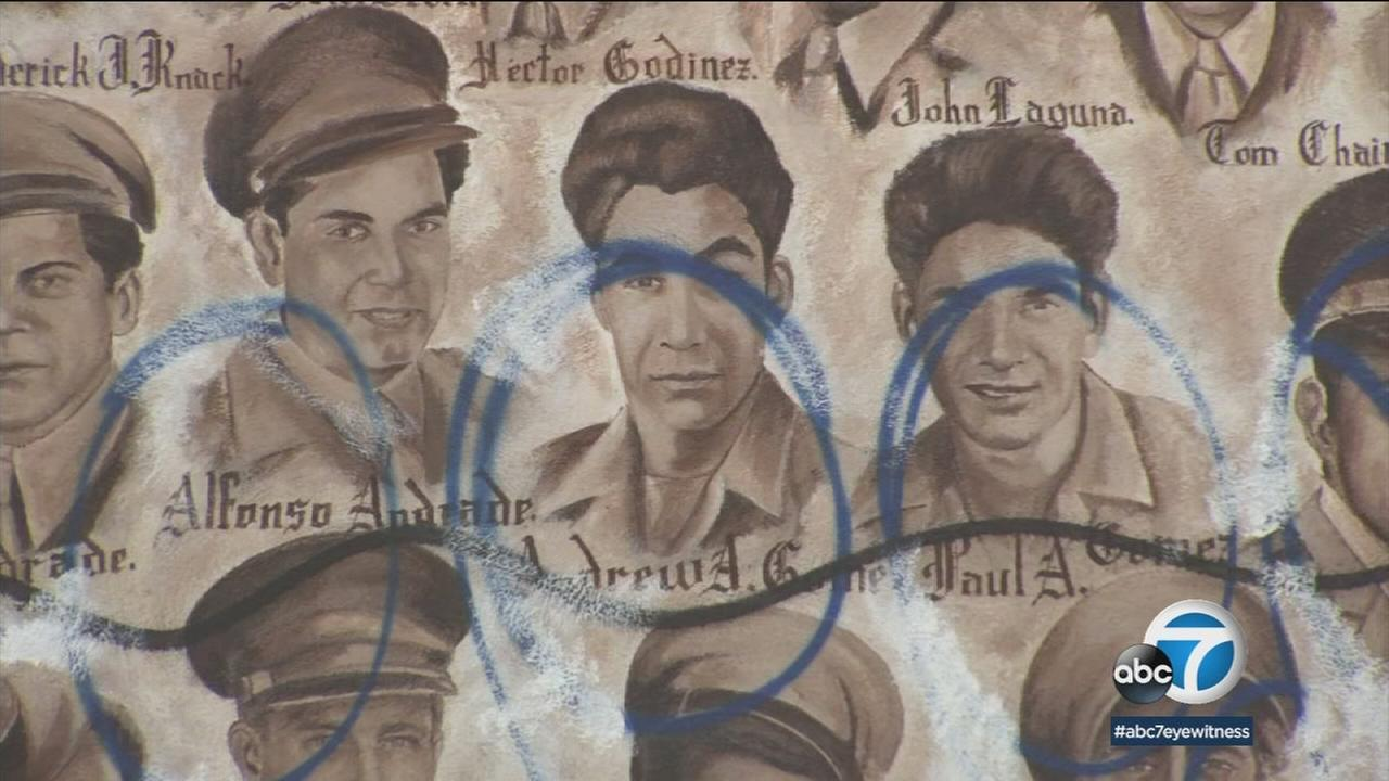Vandalism over parts of a veterans memorial mural in Santa Ana is shown.