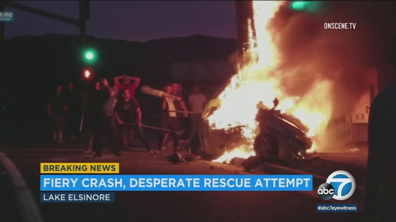 Video shows good Samaritans attempting to rescue a person from a burning car following a crash in Lake Elsinore on Sunday, April 1, 2018.