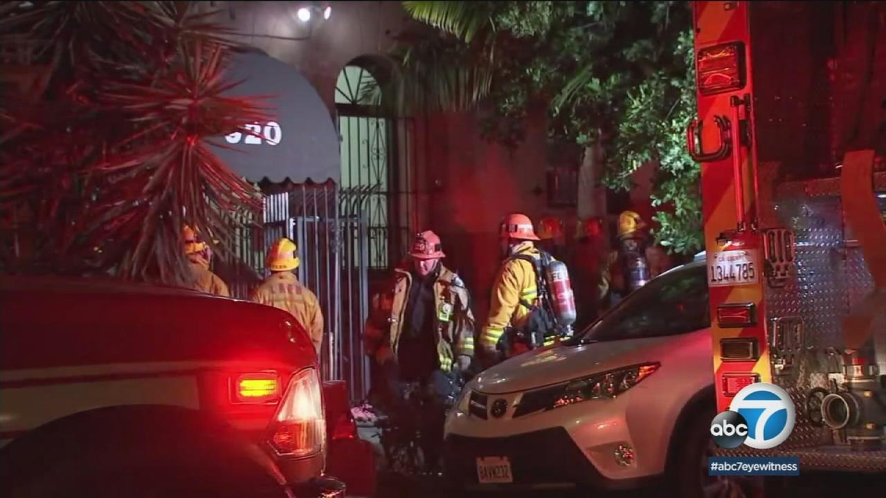 Authorities are shown at a Koreatown apartment building, where a person was found dead in their unit. The coroner is investigating if it was carbon monoxide poisoning.