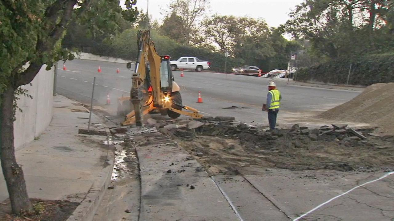 Crews fix a broken water main in Holmby Hills on Monday, Sept. 29, 2014.