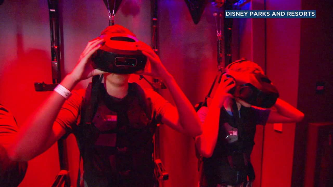 People put on gear to take part in the Star Wars: Secrets of the Empire experience at Downtown Disney.