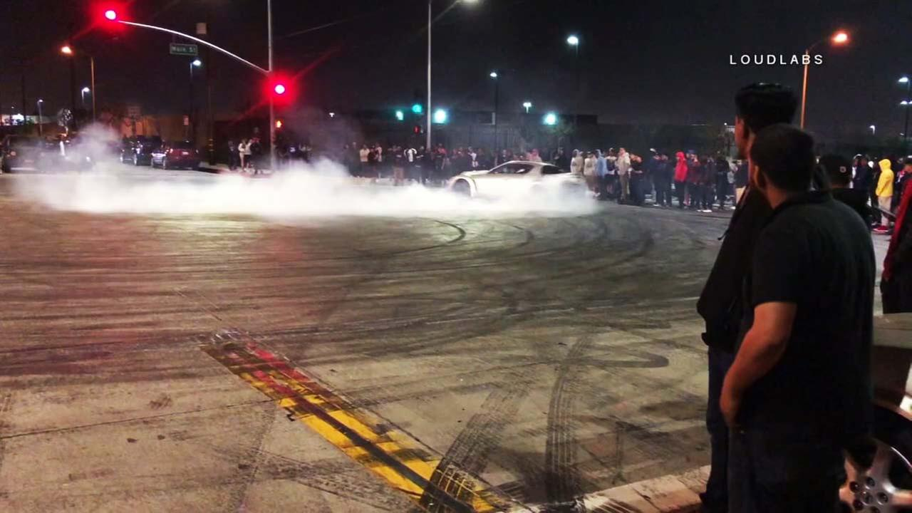 A car skids during an illegal sideshow in Compton on Sunday, April 8, 2018.