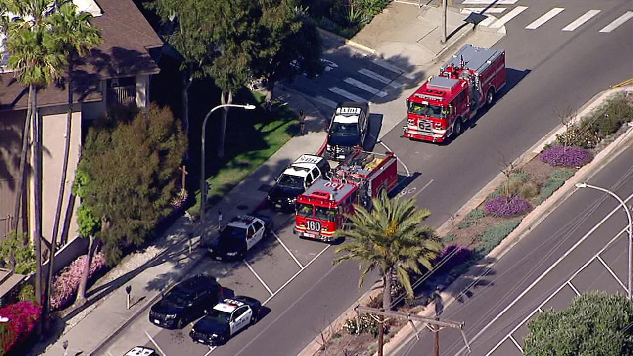 Firefighters responded to the scene of a reported blaze at a Hermosa Beach apartment but were unable to enter the building because a possibly armed man was inside one of the units.