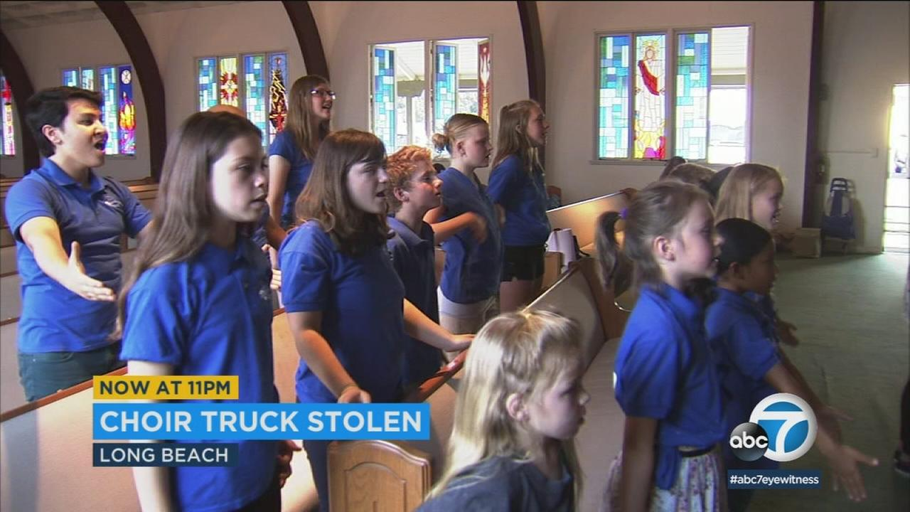 The International Peace Choir performs after their instruments were stolen in Long Beach.