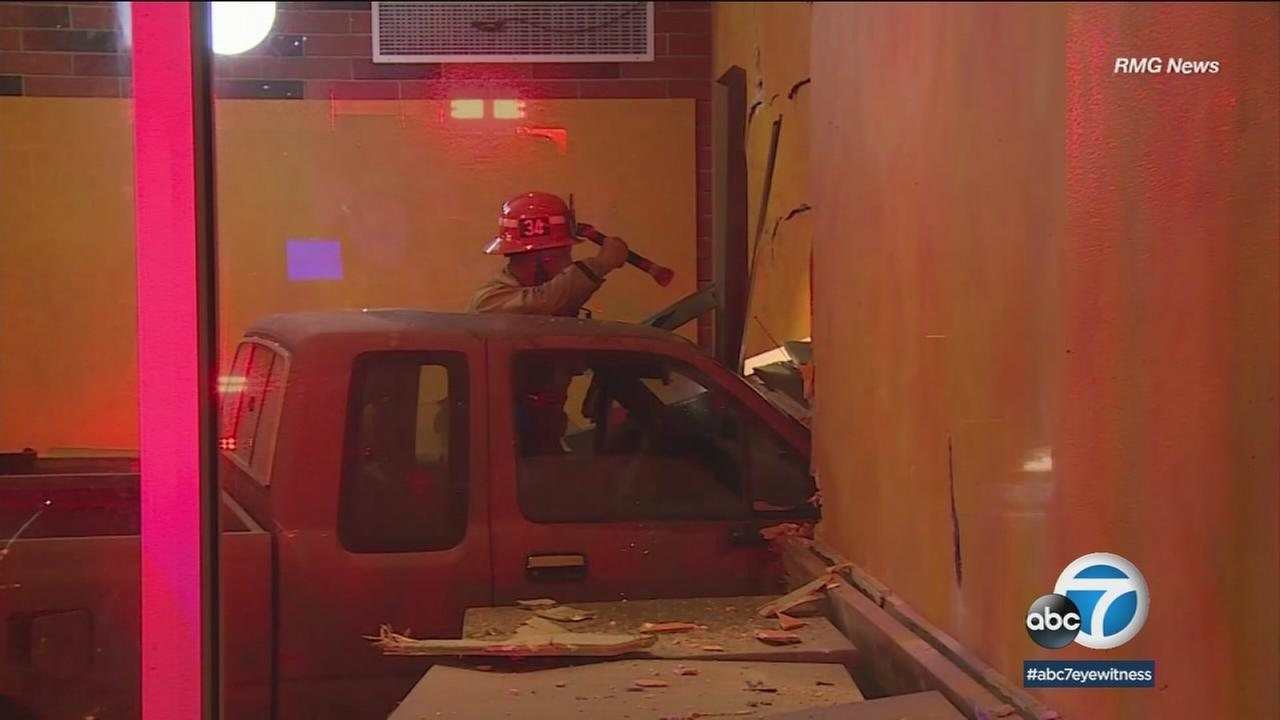 A pickup truck inside a South Los Angeles restaurant after crashing into it on Wednesday, April 11, 2018.