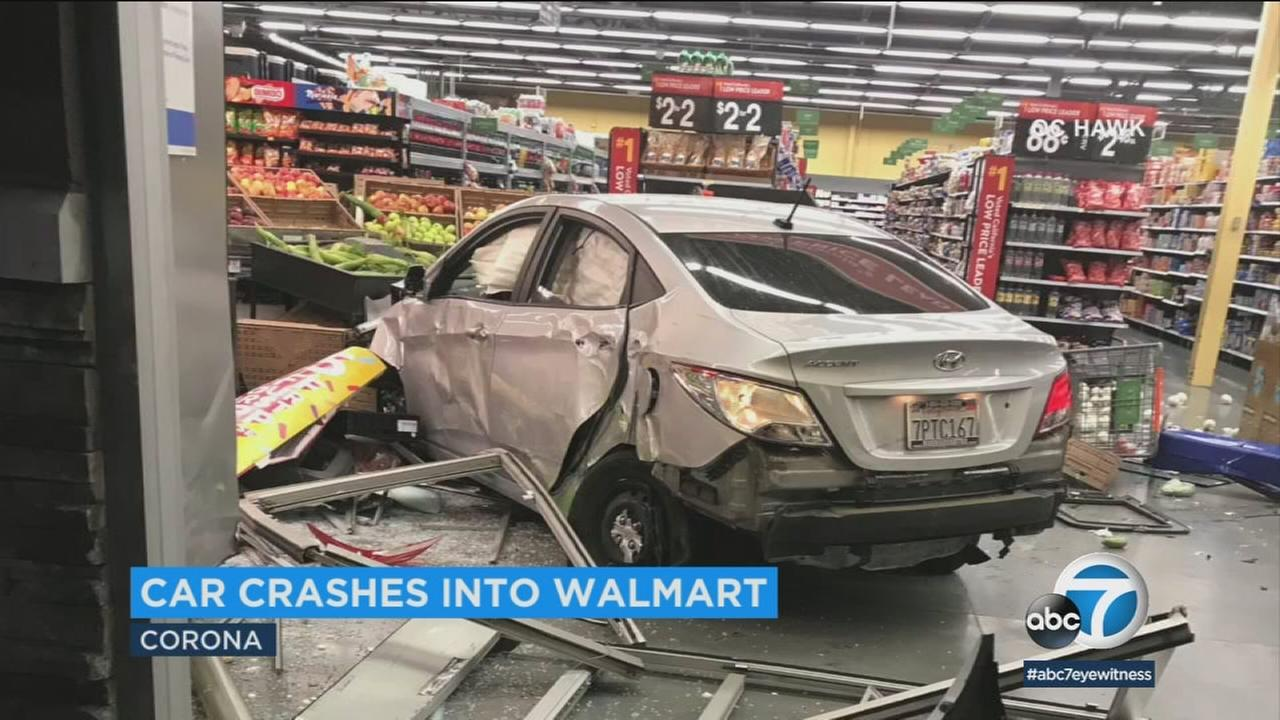 A Walmart in Corona had its front sliding glass doors shattered on Sunday night when a car crashed straight through it.