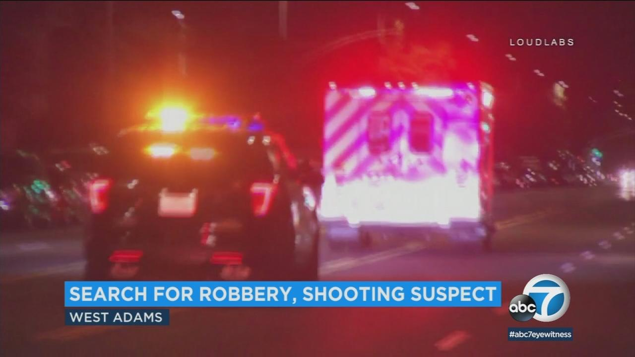 The LAPD says a man was shot during a robbery in the West Adams district early Wednesday morning.