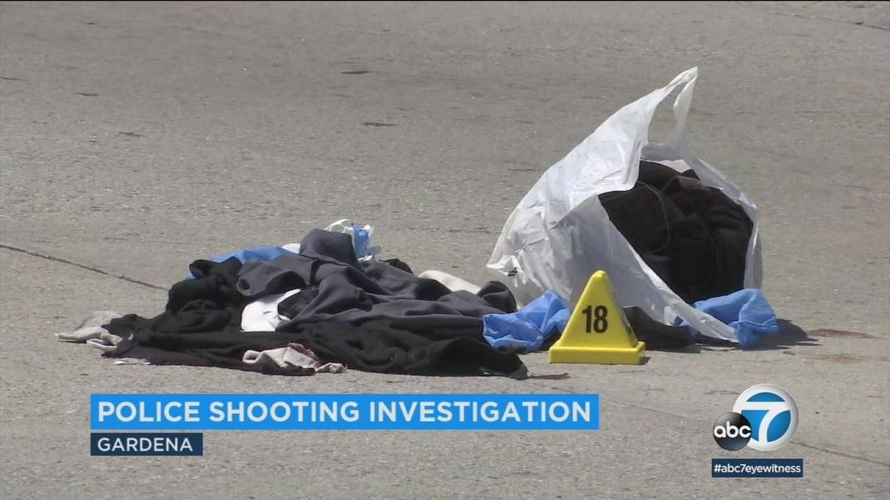 Gardena police officers shot and wounded a man in the hand after he allegedly lunged at them with a knife, officials said.