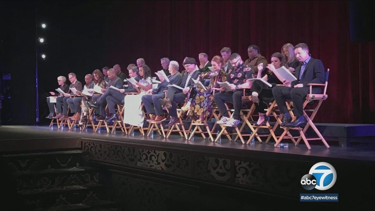 The entire cast of Scandal is shown during a benefit in Hollywood.