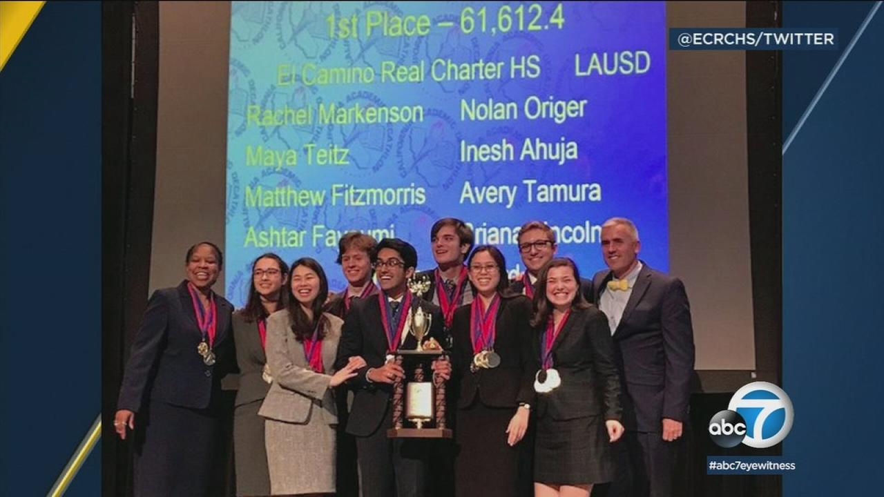 The eight-student team from El Camino Real Charter High School are shown celebrating their title win at the National Academic Decathlon.