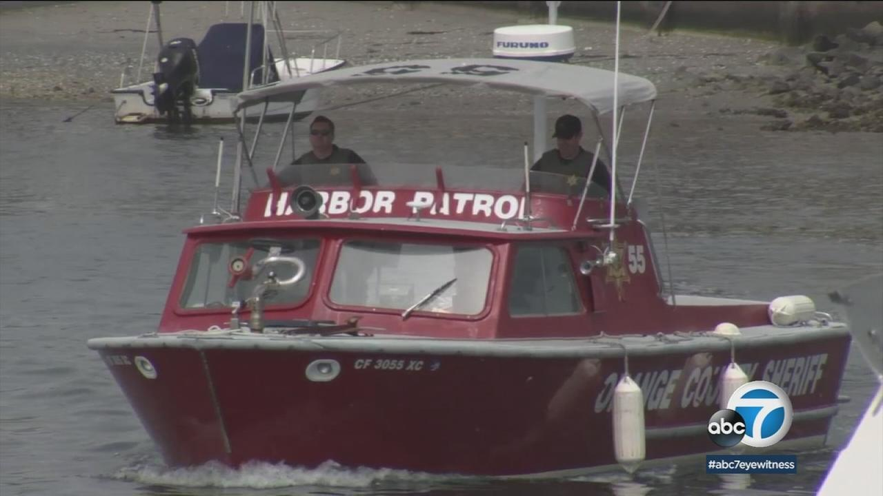 A harbor patrol boat is shown in the harbor after a search for a missing man was called off when his boat washed ashore.