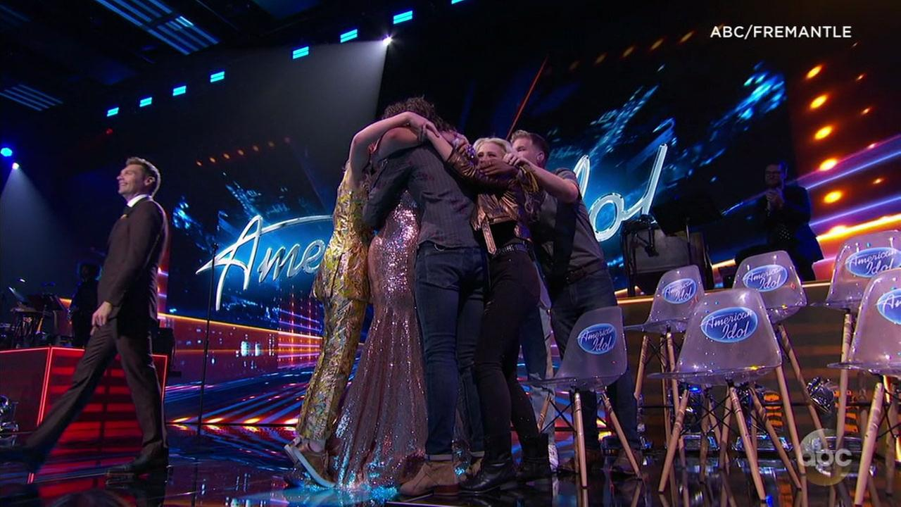 American Idol contestants hug during the top 10 competition on Monday night.