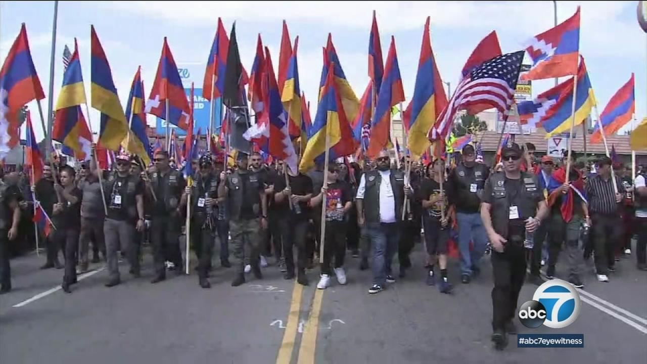 A group of people march with Armenian flags to have people recognize the Armenian genocide that happened 103 years ago.