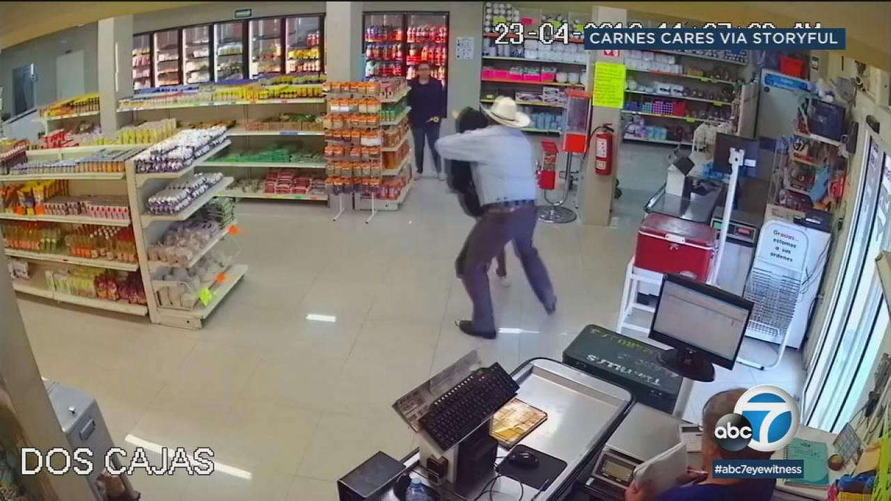 A cowboy wrestles an armed robber at a butcher shop in Mexico.