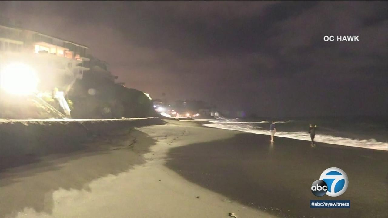 A giant spotlight is shown on Laguna Beach after a woman went missing after going swimming in the ocean,