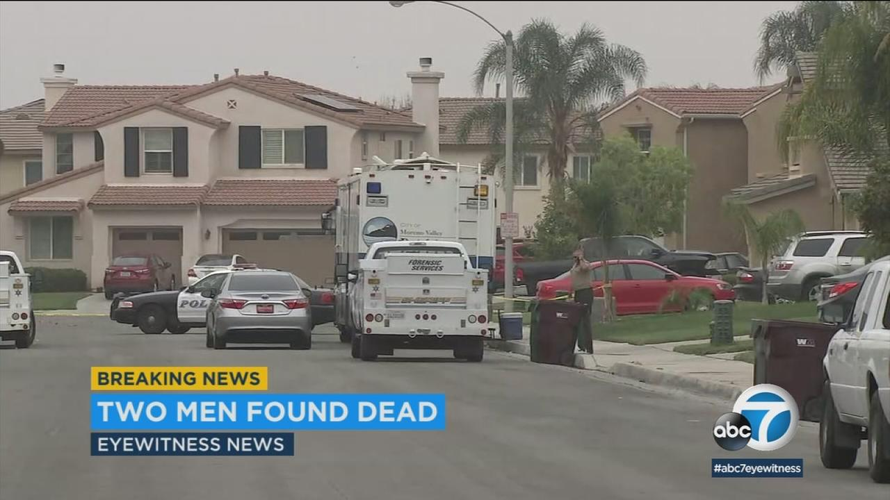 Crime scene tape ropes off the scene in Moreno Valley, where two men were found dead on the street.