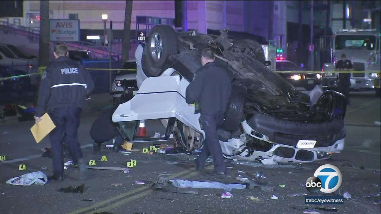 An overturned SUV sits on a Beverly Hills street following a fatal crash that left one woman dead and five others injured early Friday, April 27, 2018.