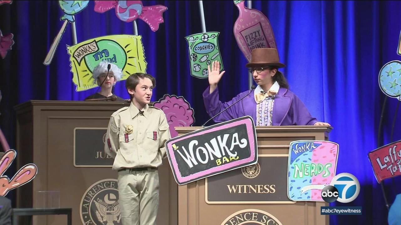 A student dressed up as Willy Wonka is shown on the stand during a mock trial so students can learn about the judicial system at a Valley Glen school.