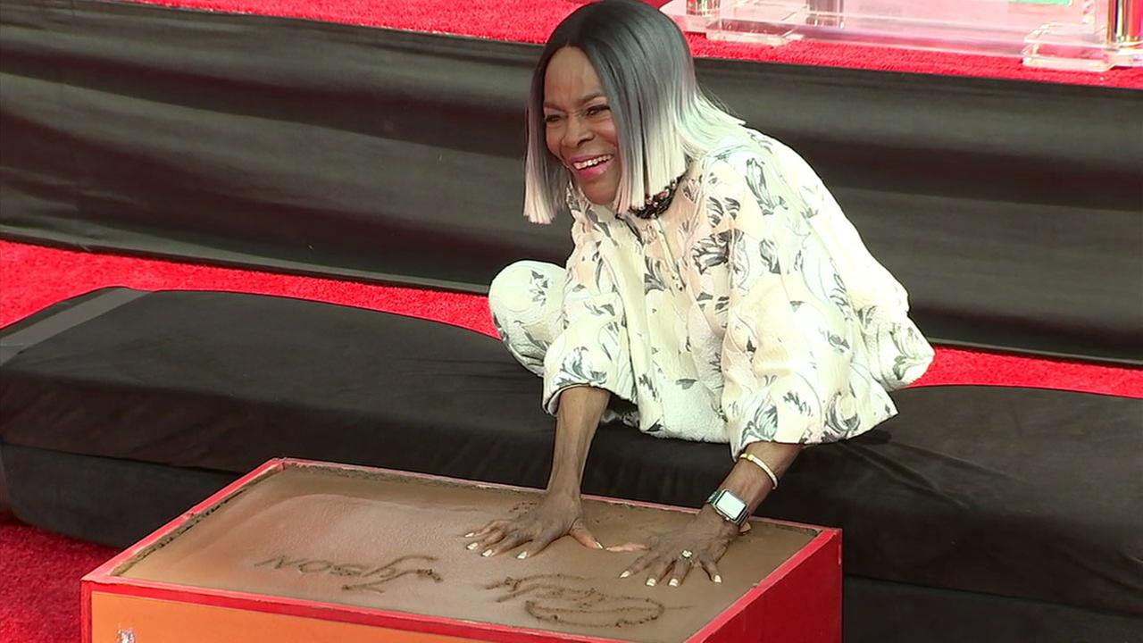 Actress Cicely Tyson is shown putting her handprints in cement at the TCL Chinese Theatre in Hollywood.
