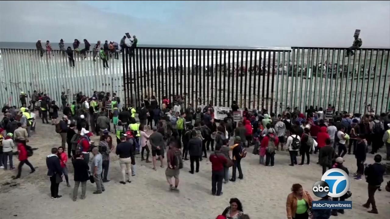 Central Americans who traveled in a caravan through Mexico to the border with San Diego began turning themselves to U.S. authorities to seek asylum Monday.