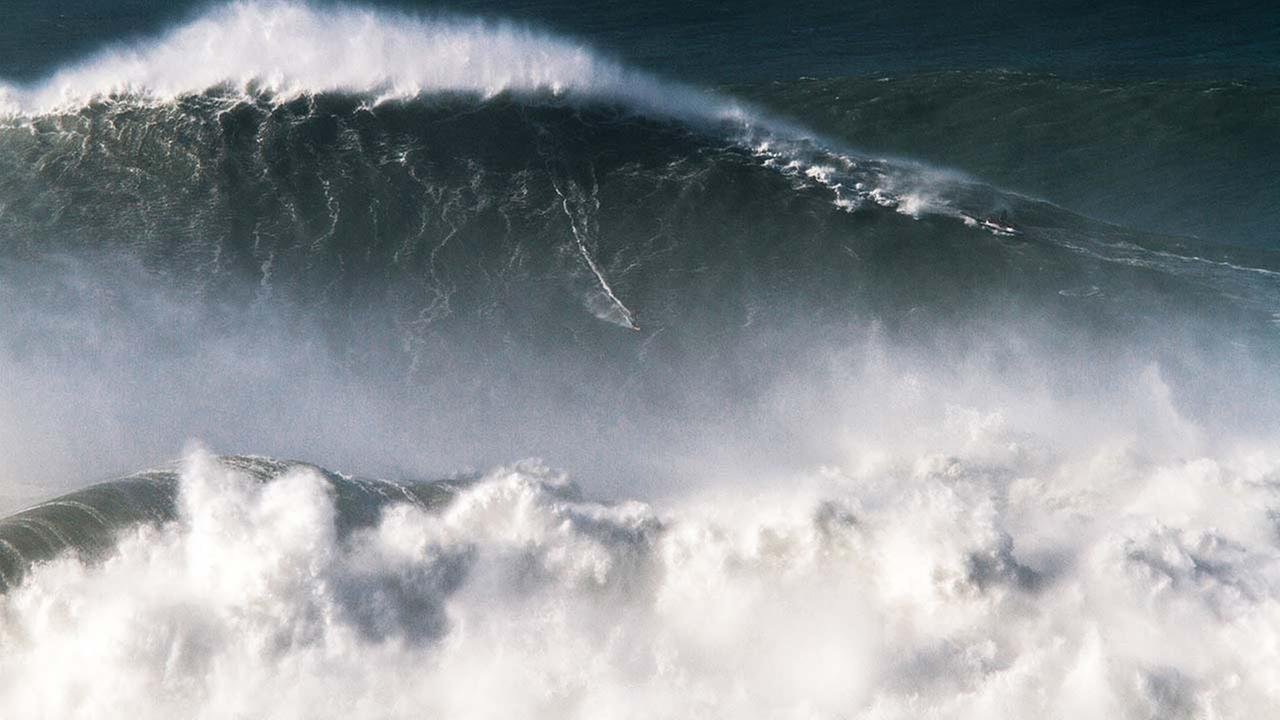 In this photo taken Nov. 8 2017, Brazilian surfer Rodrigo Koxa rides what has been judged the biggest wave ever surfed, at the Praia do Norte, or North beach, in Nazare, Portugal.