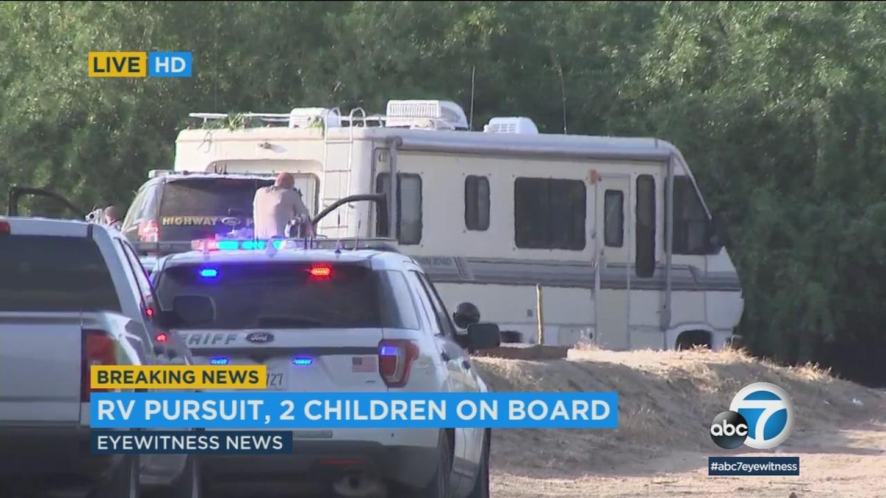 Police chased a possibly armed domestic violence suspect in an RV who had two young children with him from LA to Kern County.