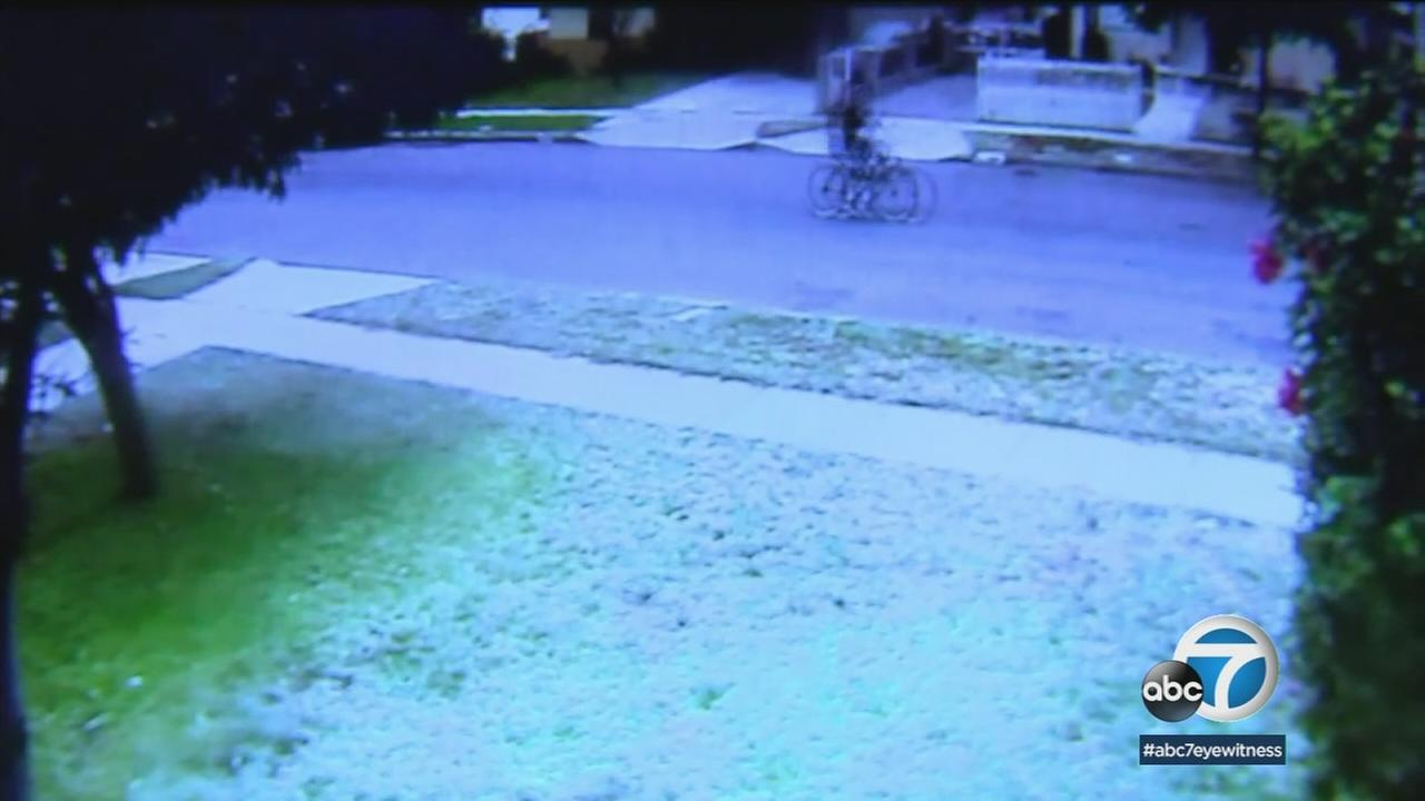 Surveillance video shows a 14-year-old teenager riding his bike through an Azusa neighborhood before he was fatally shot moments later.
