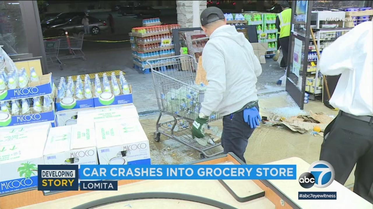 A pickup truck smashed into a supermarket Thursday evening in Lomita, injuring four people and spilling produce across the floor before the driver drove away.