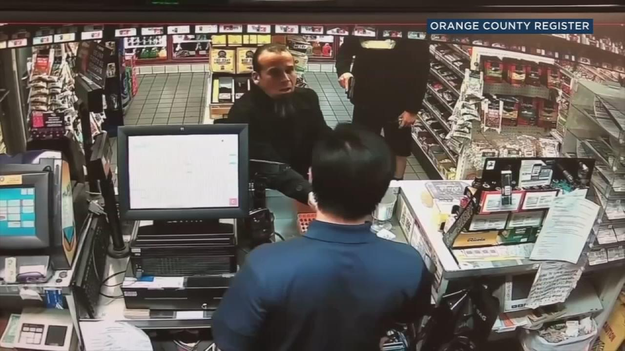 Jose Arreola is shown getting his change and putting back a pack of Mentos he bought after an off-duty officer mistakenly suspects he stole it and orders him to leave.