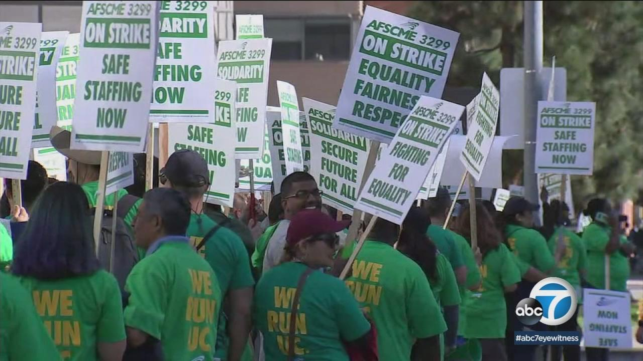 UC workers held signs as they marched during their strike in Westwood, Los Angeles.