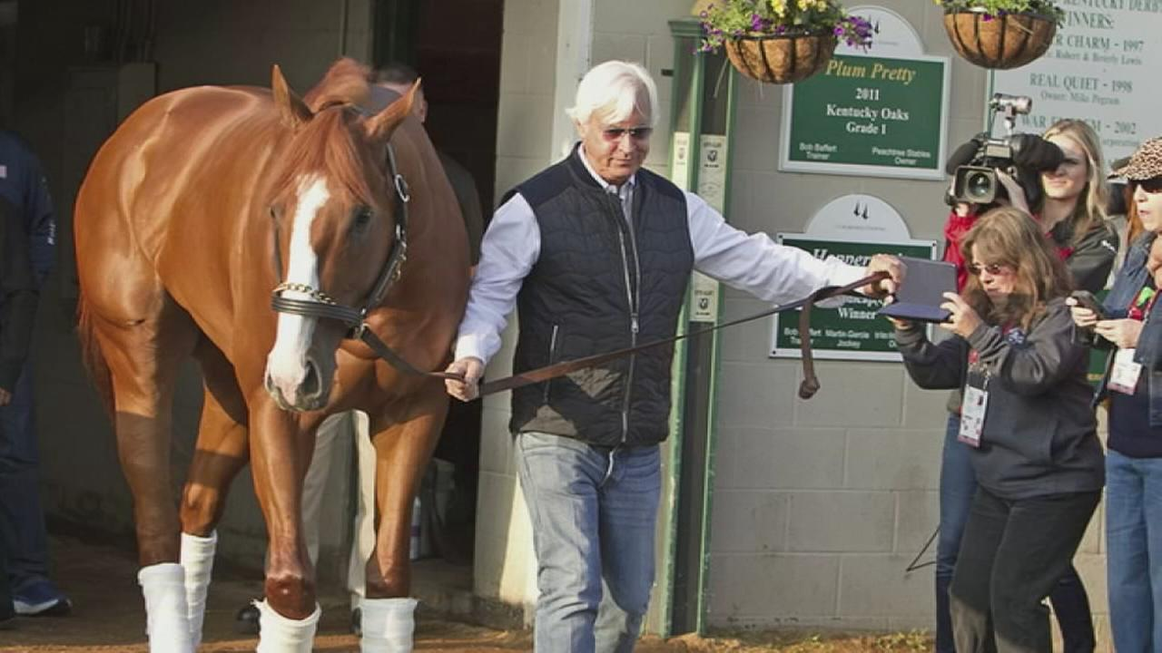 Trainer Bob Baffert is shown taking in one of his horses in a file photo.