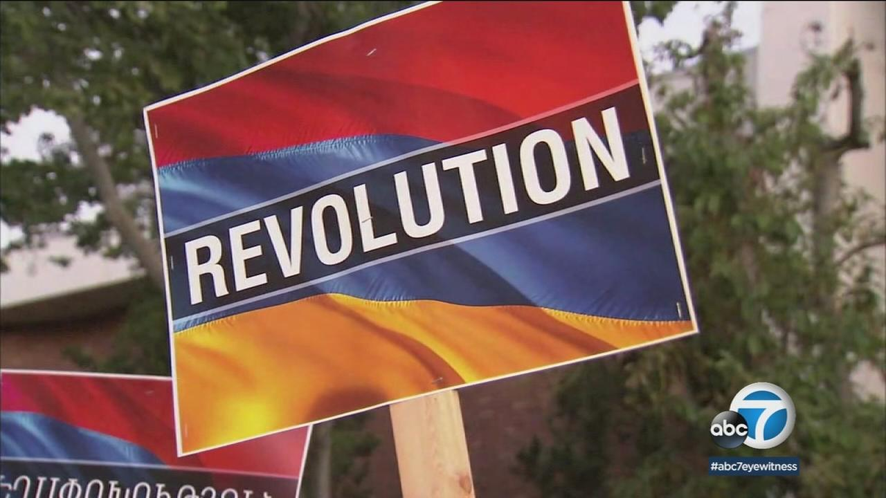A poster saying Revolution is shown at an Armenian rally over the upcoming election in the country.