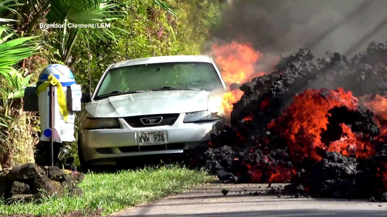 Timelapse footage shows lava from the Kilauea volcano swallowing a parked car.