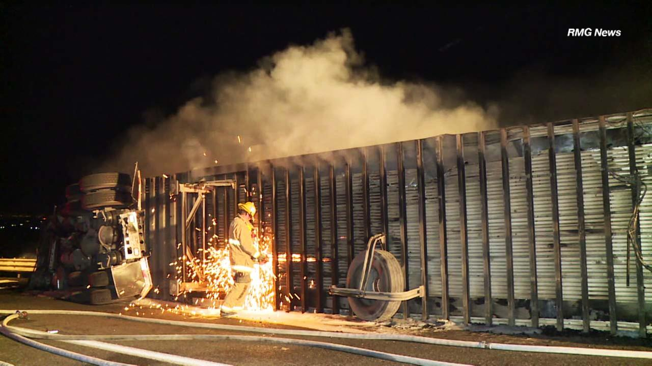 A firefighter is seen near on the 5 Freeway, where multiple vehicles were involved in a fiery wreck along the Grapevine.