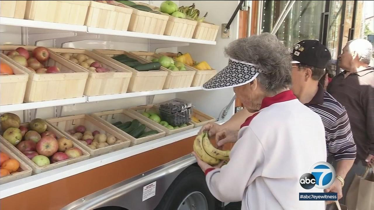 Senior citizens in Anaheim picked out fresh fruits and vegetables as well as other food from a first-of-its-kind mobile market.