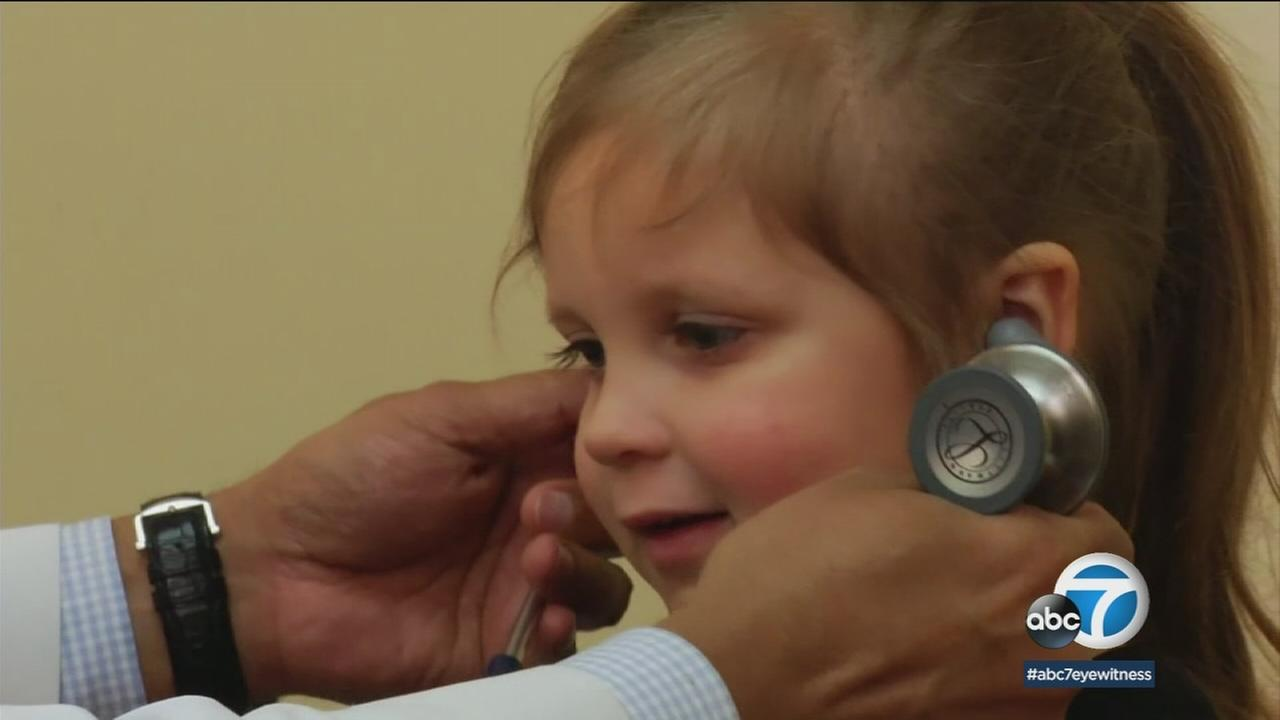 A child is shown during a medical visit.