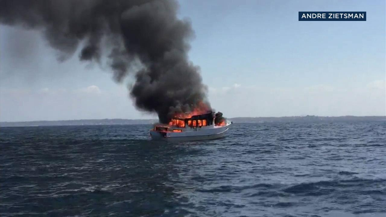 An image shows flames and smoke from a boat fire far off the coast of Redondo Beach on Monday, May 14, 2018.